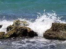 Waves Crashing in the Lime Rock royalty free stock images