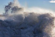 Waves crashing at Lossiemouth. Stock Photos