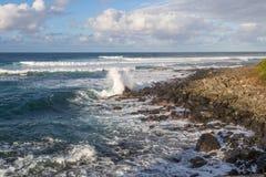 Waves Crashing on the Maui Coast. Ocean waves crashing along the rocky Maui coastline Royalty Free Stock Photos