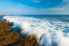 Waves Crashing Motion Blur Rocks Little Andaman. Motion blurred waves crash over the rocks of the rocky coastline of rarely visited Little Andaman Island in the Royalty Free Stock Photos