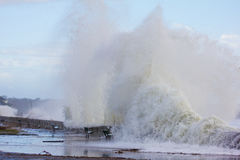Waves Crashing at Narragansett Town Beach. Explosive waves, the result of Hurricane Sandy crash against the seawall at Town Beach in Narragansett, RI