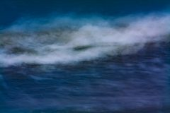 Waves crashing the ocean. Deep blue sea with the waves caught in abstract. taken on Benbecula royalty free stock photography