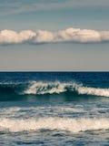 Waves crashing onto beach in Corsica Royalty Free Stock Image