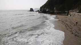 Waves crashing onto Charlestown beach near St Austell Cornwall England UK Stock Photos