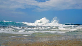 Waves crashing onto a reef Royalty Free Stock Image