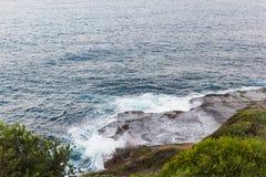Waves crashing onto the rocks along the Bondi to Coogee coastal walk, Sydney, Australia Royalty Free Stock Photos