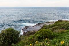 Waves crashing onto the rocks along the Bondi to Coogee coastal walk, Sydney, Australia Royalty Free Stock Photo