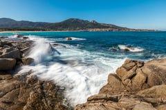 Waves crashing onto rocks near Algajola beach in Corsica. Slow shutter image of waves crashing onto rocks near Algajola beach in the Balagne region of Corsica stock images