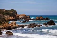 Waves crashing onto rocks Stock Photo