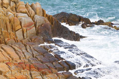 Waves crashing onto rocks Stock Photo