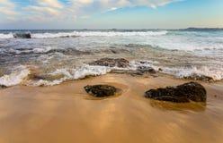 Waves Crashing onto Sand on a Pacific Ocean Beach in Australia Stock Photo