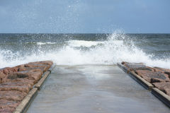 Waves Crashing. Over jetty in rough serf Royalty Free Stock Image