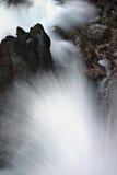 Waves crashing over lava Royalty Free Stock Images