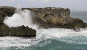 Waves Crashing Over Rocks Royalty Free Stock Photos