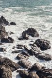 Waves crashing over rocks in NZ. Shot taken in Mt. Maunganui stock photo