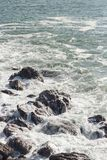 Waves crashing over rocks in NZ. Shot taken in Mt. Maunganui royalty free stock images