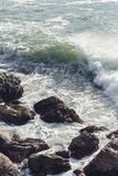 Waves crashing over rocks in NZ. Shot taken in Mt. Maunganui stock photos