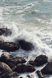 Waves crashing over rocks in NZ. Shot taken in Mt. Maunganui stock photography
