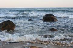 Waves Crashing Over Rocks Stock Photos