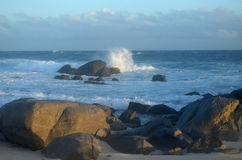 Waves Crashing and Pounding the Rocks Along Aruba`s Coast Royalty Free Stock Photo