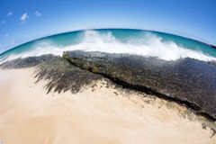 Waves crashing into reef Stock Images