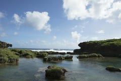 Waves crashing on rock formation Royalty Free Stock Photo