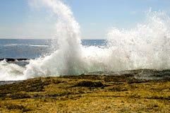 Waves crashing on rocks royalty free stock photography