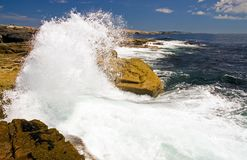 Waves crashing on rocks. A close up view of ocean waves crashing into the rocks on the scenic Maine coast at Schoodic Point stock image