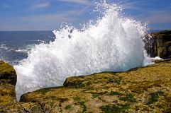 Waves crashing on rocks. A close up view of ocean waves crashing into the rocks on the scenic Maine coast at Schoodic Point stock photos