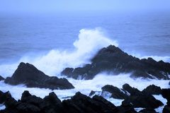 Waves crashing on rocks Stock Image