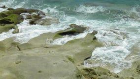 Waves. Crashing into the rocks stock photo