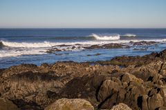 Waves crashing on rocks on Atlantic Ocean beach. Scenic seascape. Beautiful surf at seaside. Splashing waves with foam. Travel and vacation on shore. Rocky stock photos