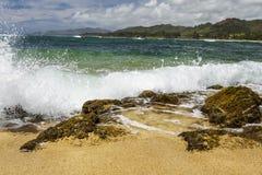 Waves crashing rocks on beach Royalty Free Stock Photos