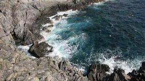 Waves crashing on the rocks stock footage