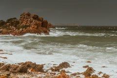 Waves crashing on rocks, Bretagne, France Stock Images
