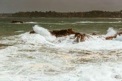 Waves crashing on rocks, Bretagne, France Royalty Free Stock Photos