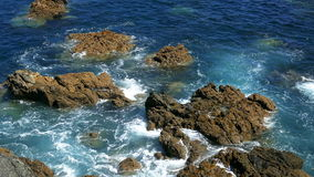 Waves Crashing on Rocks stock footage