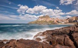 Waves crashing on rocks at Castelsardo in Sardinia Stock Images