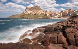 Waves crashing on rocks at Castelsardo in Sardinia Royalty Free Stock Photos