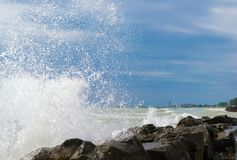 Waves crashing on rocks. A close up view of ocean waves crashing into the rocks stock photography