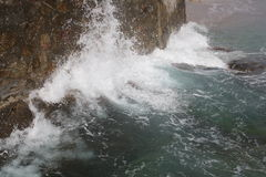 Waves crashing on rocks. A close up view of ocean waves crashing into the rocks on Stock Photography