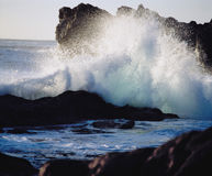 Waves crashing on rocks at coast Royalty Free Stock Image