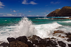 Waves crashing on rocks on the coast of Oahu, Hawaii Stock Photos