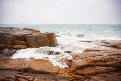 Waves crashing on rocks at coast Stock Photos