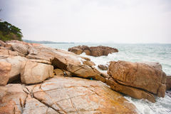 Waves crashing on rocks at coast Stock Photography