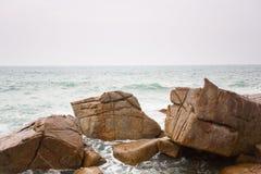 Waves crashing on rocks at coast Stock Image