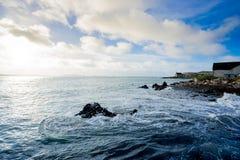 Waves crashing on rocks on coastline. Waves crashing on rocks on iona scotland Royalty Free Stock Image
