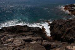 Waves crashing on the rocks  Stock Image