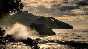 Crashing waves at sunset. Waves crashing on rocks in Manuel Antonio Costa Rica at sunset stock photography