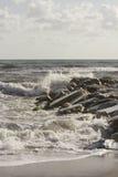 Waves crashing into rocks in Marina di Massa. MARINA DI MASSA, ITALY - AUGUST 17 2015: Waves crashing into rocks in Marina di Massa, Italy Stock Images